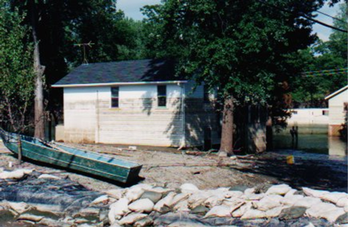 The high water mark left by floodwater is visible half-way up the windows. SCCDEM photo
