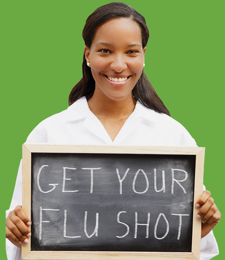 Woman holding chalkboard sign that reads: &#34Get Your Flu Shot&#34