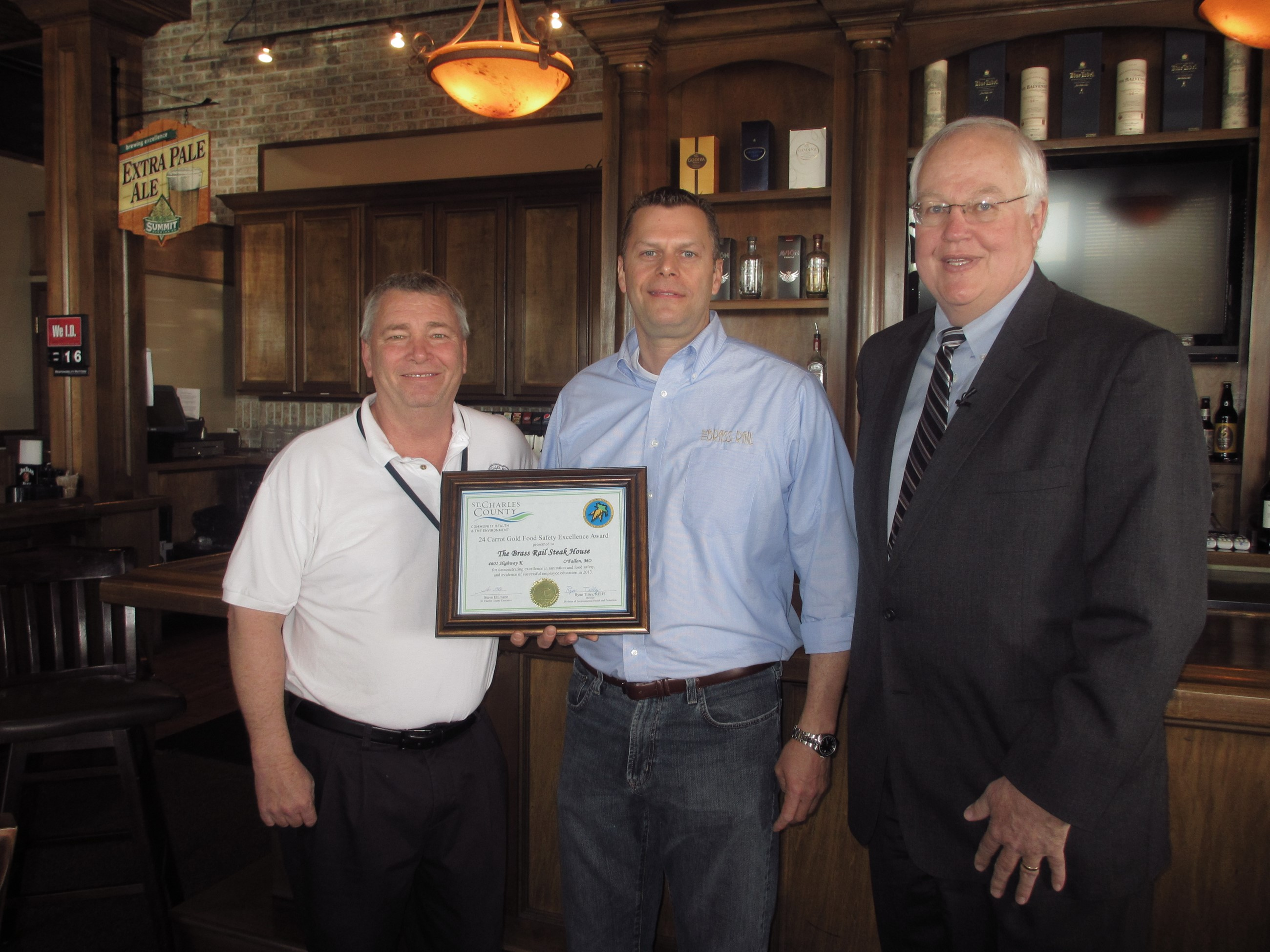 County Executive Ehlmann presents 24 Carrot Food Safety award to The Brass Rail ownership