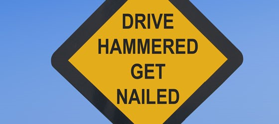 Drive Hammered Get Nailed sign
