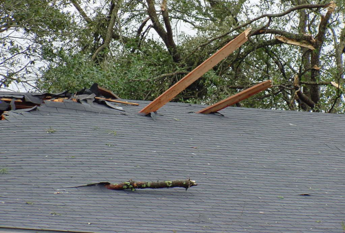 Roof damaged by wind and penetrated by debris. NSSL / NOAA Photo Library Collection